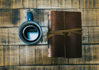 Photograph Taken By Jacob Lange of Coffee Mug and Journal On Coffee Table